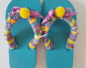 Girls Turquoise Flip Flops Crocheted with Multi Colored Yarn and Yellow Pom Poms