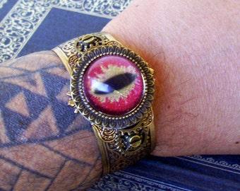Dragon Eye Cuff (C704), Hand Painted Glass Eye, Brass Bracelet, Framework, Gears, Red Gold Sparkle