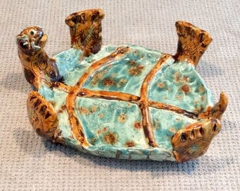 Turtle dish handmade in U.S. from a lump of clay.