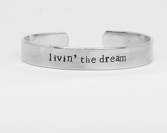 Livin' the dream: hand stamped aluminum reminder cuff bracelet