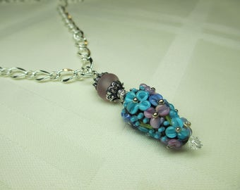Floral Lampwork Bead Pendant Necklace in Black With Purple Floral Design