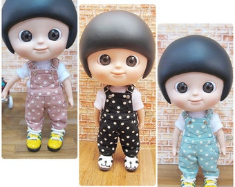 Mui Chan : white polka dot overalls