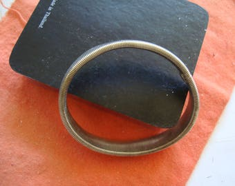 Expansion  BRACELET is SILVER METAL, 1/2 inch wide, looks near new.  see desctiption area for detail