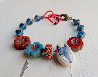Missing all the flowers - handmade artisan bead bracelet in russet red-orange, royal blue with blue wolf  - Songbead UK, narrative jewellery