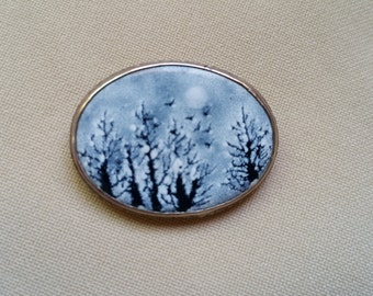 hand painted ceramic brooch and pendant with sterling silver frame