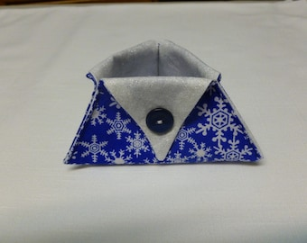 Blue and white snowflake thread catcher for sewing or craft projects