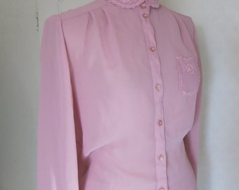 Pink blouse with romantic details