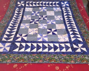 Blue pinwheel and flying geese crib quilt
