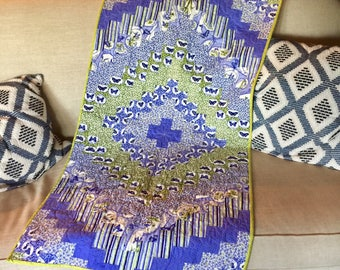 Purple/lilac quilted table topper.