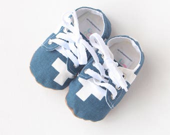 Baby shoes / toddler sneakers- lace up soft soled shoes in blue cross pattern.