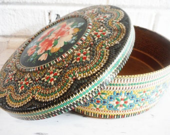 Vintage tin box round shabby ,dimensional surface tin, floral tin,black red green,mid century tin,pretty floral tin storage,tin sewing box