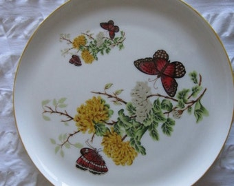 Hand decorated plate with flowers and butterflies