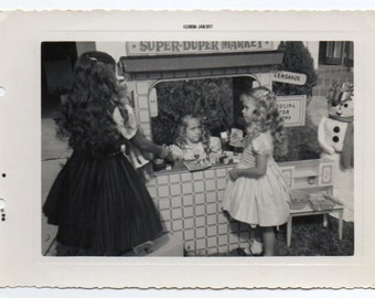 Girls Playing Grocery Store January 1957 Vintage Snapshot Mid Century Modern Photo Children At Play Black And White Photograph