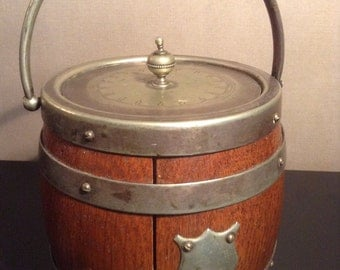 Antique English oak biscuit barrel with porcelain liner