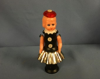 Art doll assemblage sculpture using a mid-century vintage doll