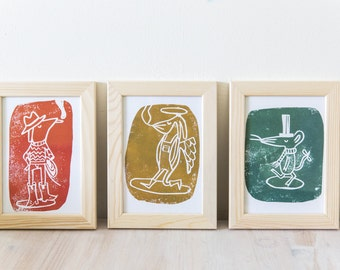 A set of three linocut artprints