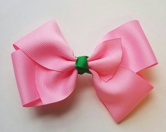 Pink and Green handmade bow with knotted center ribbon