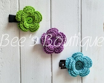 set of 3 crochet flowers with button embellishments on lined alligator clips