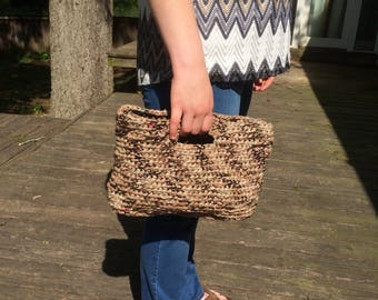 Crocheted clutch made with brown recycled plastic bags