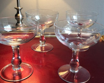 Vintage etched glass champagne saucers