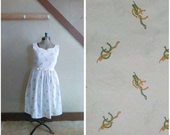 20% OFF / Such Good Luck 1950s White Dress with Green/Gold Horseshoe/Riding Crop Novelty Print