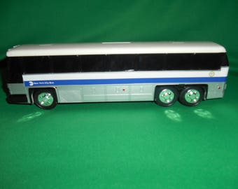 One (1), New York City Bus, Plastic Bank, from Royal Coach. No Box.