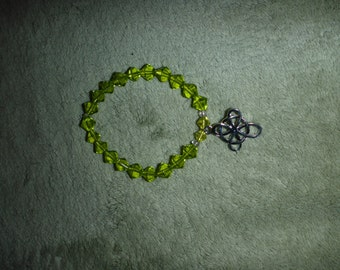 Chartreuse glass bead bracelet with Irish Celtic knot charm