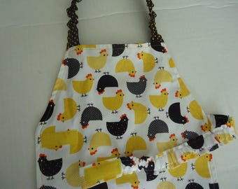 Unisex Child sized apron for baking, crafts, cooking , keeping clothes clean .  Hen print in yellows and blacks.