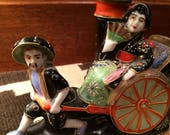 Very Small Ceramic Dresser Lamp With A Woman Riding in a Rickshaw