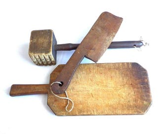 Handmade Old Wooden Cutting Board With Hammer and Cleaver .
