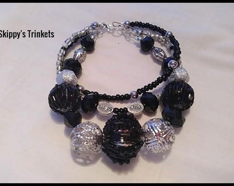 Black and Silver Hope and Believe Three Strand Beaded Braclet