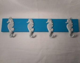 Cast iron sea horse coat rack / towel rack / beach decor