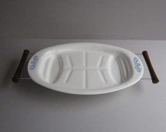"""A Cornflower Blue by Corning 16"""" Oval Roaster, with Metal Trivet and Wood Handles"""