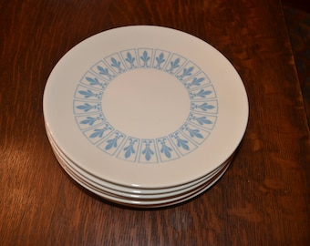 Set of seven vintage pristine Mid-Century Modern Homer Laughlin Fleur de lis dessert plates