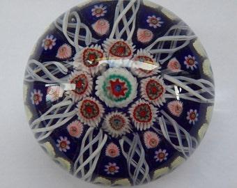Beautiful VASART Scottish Glass Paperweight with 9 Spokes; with dark blue ground, latticino canes & millefiori
