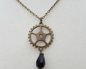 Steampunk necklace - cogs and black bead drop in antique bronze