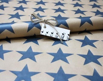 star design gift wrap, sheet of hand printed wrapping paper, 50 x 75cm kraft paper with blue stars design