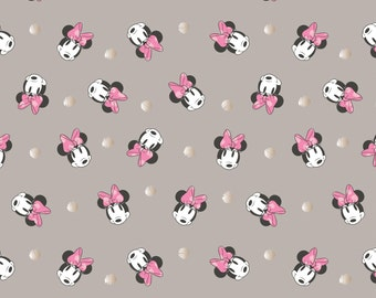 Minnie Mouse Metallic fabric by Camelot. 85270203-3.Deep gray with black/white Minnie faces and Big pink bows.  Champagne polka dots.