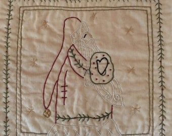 Primitive hand embroidered Santa candle mat