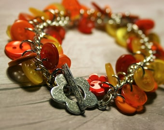 Red, orange and yellow button bracelet, charm style button bracelet, handmade button bracelet, flower clasp