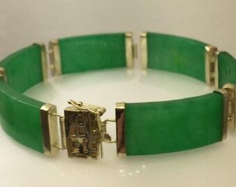 Green jade 14kt gold link bracelet.