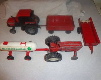 5  metal International IH  farm pieces,2 tractors,wagon ,manure spreader and a fertilizer tank about 5 inches long each