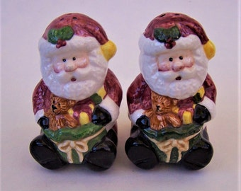 Vintage Santa Claus Bearing Gifts Salt and Pepper Shakers