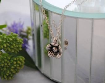 Silver flower pendant necklace