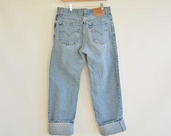 "Women's Levi's jeans Size 11 Junior Guy's Fit Vintage 90's Era Light faded Wash 33"" waist 41"" hips"