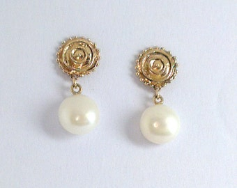 Disc shaped earring studs with Fresh Water Button Pearls. Solid  9 carat gold.