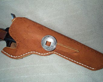 Black powder, right hand cross draw revolver holster