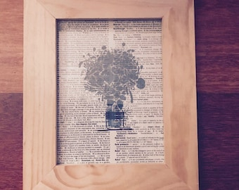 Vase print on vintage dictionary page