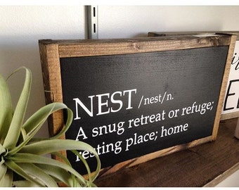 "Nest 8x13"" painted wooden sign."