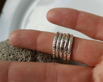 Hand stamped stacking rings, made to order, just choose your design. Made using sterling silver wire. Hand made in Wales